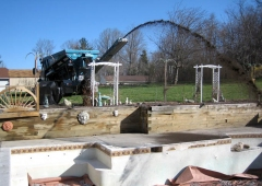 Ultra 18 Stone Slinger filling in an unused pool